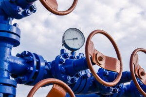 Wellhead with valves and manometer. Oil and gas concept.